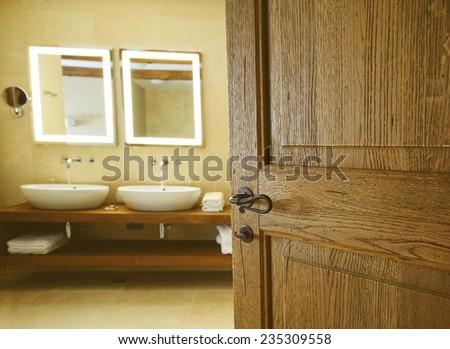 bathroom for an open wooden door  Two sinks for bathrooms and two mirrors   Tap. Bathroom Door Stock Images  Royalty Free Images   Vectors
