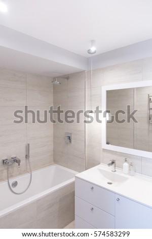Bathroom Interior. Bathroom Mirror With A Stand Mirror Table