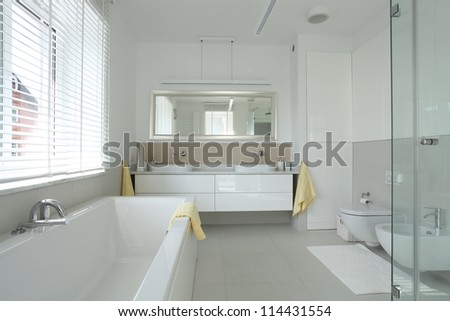 Bathroom interior in modern and stylish house - stock photo