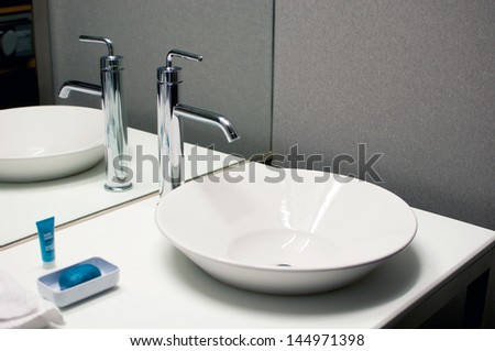 Bathroom interior sink with modern design - stock photo