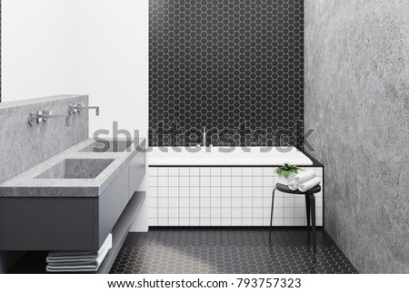 Bathroom Interior With Black Hexagon Tile And Concrete Walls A Large Angular Tub