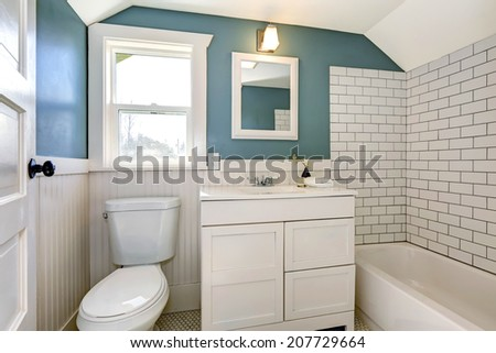 Bathroom interior with tile and plank wall trim - stock photo