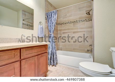 Bathroom interior with vanity cabinet and blue shower curtain. Northwest, USA