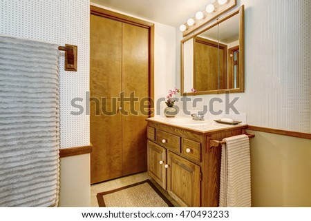 Bathroom interior with vanity cabinet, tile floor and rug. Northwest, USA
