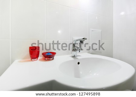 Bathroom interior with white sink and faucet - stock photo