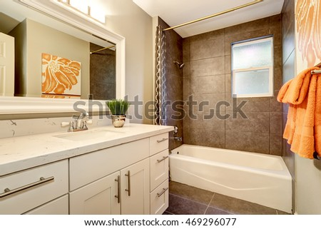 Bathroom interior with white vanity, big mirror and tile floor. Northwest, USA