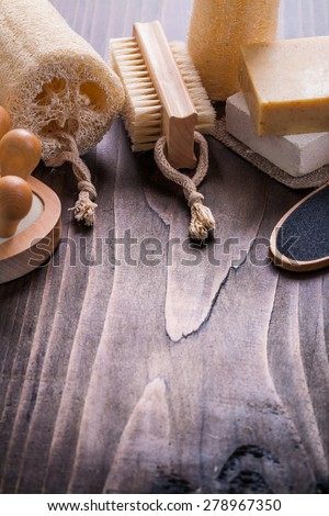 bathroom items massager sponge nailbrush bar of soap on vintage wooden board with little copyspace  - stock photo