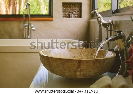 Bathroom Luxury interior decor. Water flow from tap - stock photo