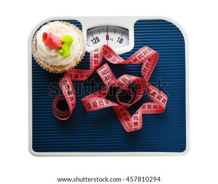 Bathroom scale, tart and measuring tape on white background. Weight loss concept - stock photo