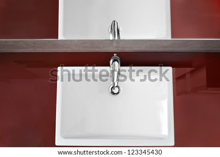 Bathroom sink and mirror reflection from above - stock photo