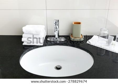 Bathroom sink at restroom resort interior  - stock photo