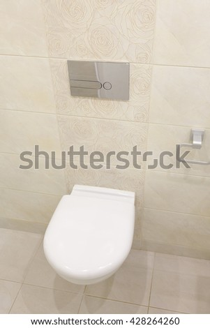 Bathroom Toilet.Modern Bathroom.Classic Toilet.Bright Interior Toilet.Equipped Bathroom Apartment.Small Toilet.Cozy Toilet.Toilet New Apartment.Wc.Small Wc.Flush Toilet.Ceramic Tiles.Beige Toilet - stock photo