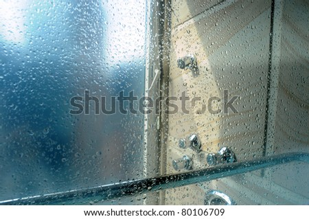Bathroom window with water drops at sunny morning - stock photo