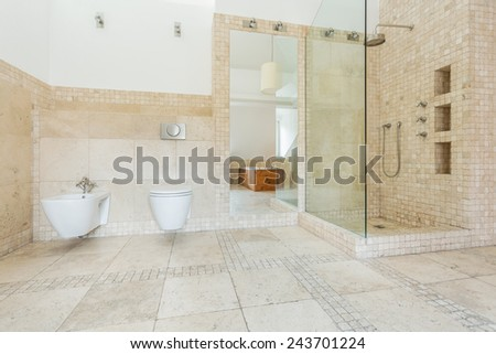 Bathroom with beige tiles on the wall - stock photo