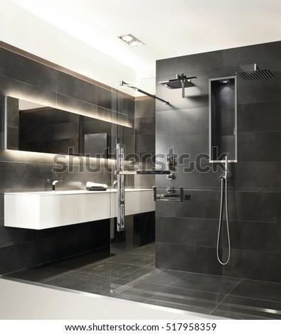 Bathroom With Grey Stone And Modern Rain Shower