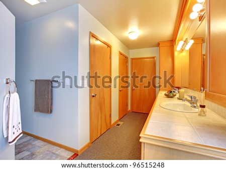 Bathroom with many doors to closets interior.
