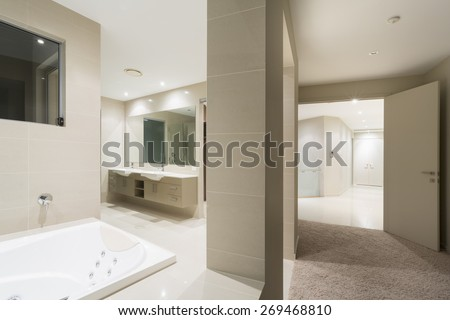 Bathroom with spa in large Australian mansion - stock photo