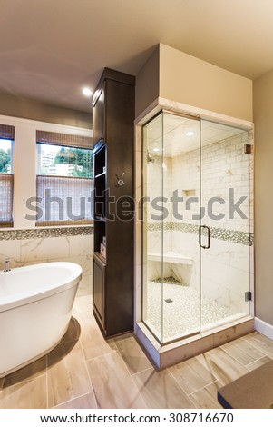 Bathtub and shower in new luxury home - stock photo