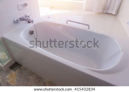 bathtub in luxury bathroom at Comfortable rooms. - stock photo