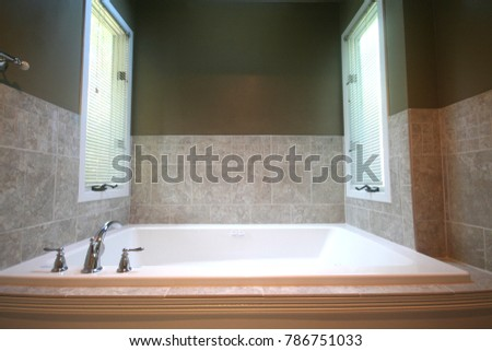 bathtub remodel with tiles