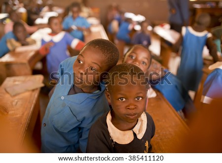 BATOUFAM - CAMEROON / 15.01.2015: Students from the primary school in Batoufam with their blue uniforms, Cameroon