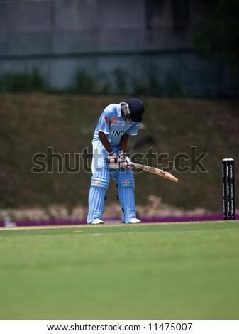 Batsman hitting cricket ball at tournament - stock photo