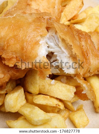 Battered cod fillet and chunky chips. - stock photo