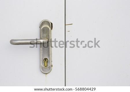 Battered metallic door handle with keyhole on white doors close-up & Battered Metallic Door Handle Keyhole On Stock Photo 568804429 ...