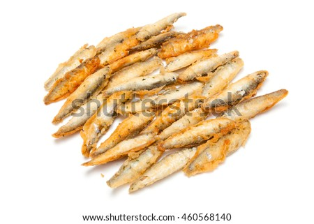 Battered whitebait sprats (Sprattus sprattus) isolated on a white studio background.