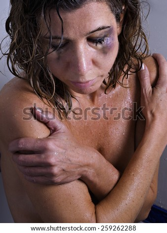 Battered women in the shower - stock photo