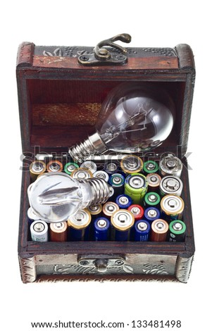 Batteries energy for a big or small  idea concept shot. Opened treasure chest with batteries and bulb lamps inside isolated on white/Energy for ideas - stock photo