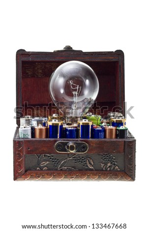 Batteries energy for an idea concept shot. Opened treasure chest with batteries and and a bulb lamp inside isolated on white/Batteries energy for an idea 2 - stock photo