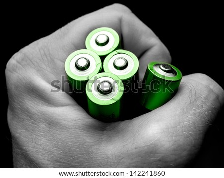 Batteries in the hand, for ecology, energy, environment related themes - stock photo
