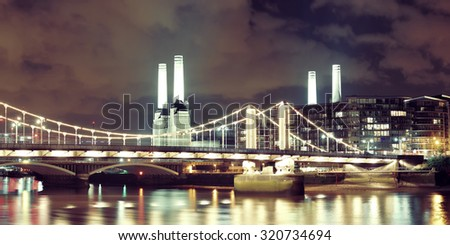 Battersea Power Station panorama over Thames river as the famous London landmark at night. - stock photo