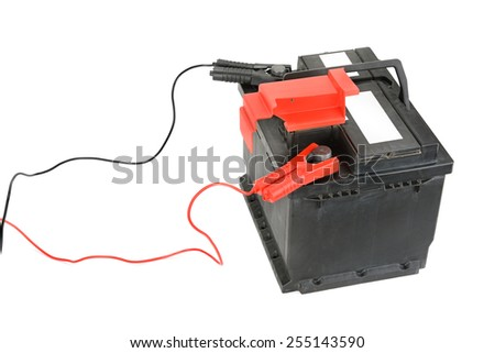 battery and charger isolated on a white background - stock photo