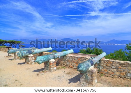 Battery of old canons aiming to the sea inside Saint Tropez fortress, French Riviera, France - stock photo