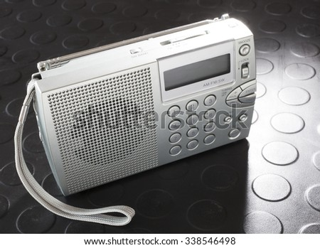 Battery powered radio that can hear shortwave and broadcast transmissions - stock photo