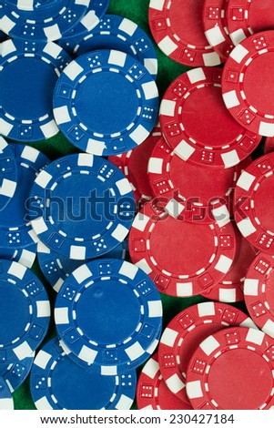 Battle Blue versus red yin vs yang Playing Poker Chips in green background
