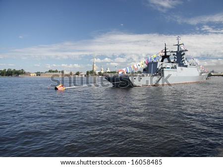 Battle ship in St.Petersburg Neva river with fortress on background