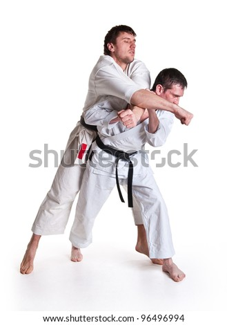 battle throw.Judo.figure in the karate fighting stance on a white background.masters of hand-to-hand fight - stock photo