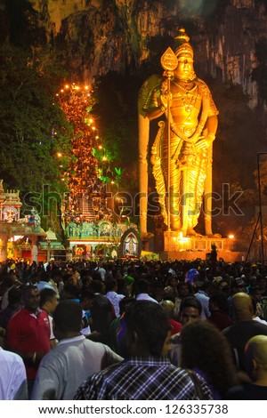 BATU CAVE, MALAYSIA - JAN 27: Crowd of people waiting in front the Murugan statue during Thaipusam in Batu Cave temple, Malaysia on January 27, 2013.
