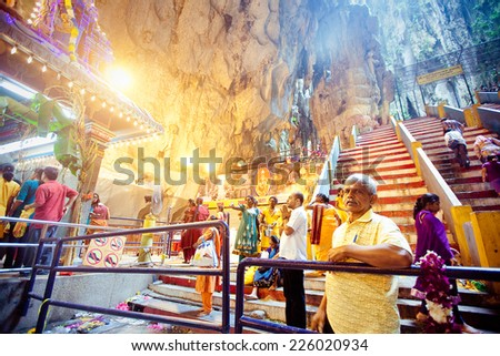 BATU CAVES, MALAYSIA - JAN 18 2014 : Thaipusam at Batu Caves temple, Malaysia on January 18, 2014. Thaipusam is a Hindu festival on the full moon in the Tamil month of Thai. - stock photo