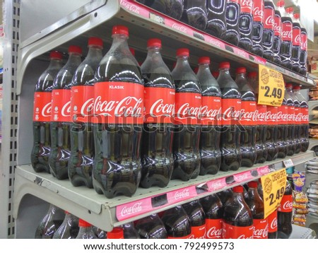 Batu Pahat, Malaysia - January 13, 2018 : Bottle carbonated drinks displayed on a rack in shop ready for sale in Johor