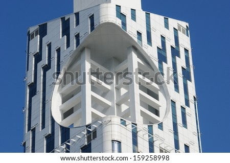 BATUMI, ADJARA, GEORGIA - SEPTEMBER 14: Batumi Technological University Tower on September 14, 2013 in Batumi. It is the first ever skyscraper with an integrated Ferris wheel. - stock photo