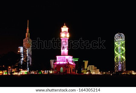 BATUMI, GEORGIA - JULY 21: The mosque, the Kempinski Hotel and Tower Alphabet on July 21, 2013 in Batumi, Georgia. In recent years Batumi is a lot of modern construction for tourism development - stock photo
