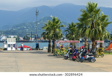 BATUMI, GEORGIA - JULY 20, 2015: Unidentified people resting near the sea in Batumi. With a population of 190,000 Batumi serves as an important port and a commercial center.