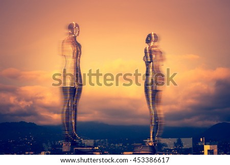 "BATUMI, GEORGIA - JUNE 6, 2016: Moving sculpture ""Ali and Nino"" by Tamar Kvesitadze at sunset. Two lovers tell the story of love in the Futurism style, modern mobile sculpture made of metal."