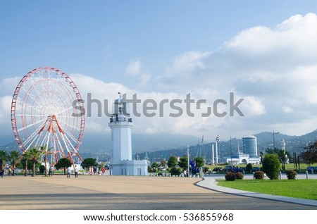 BATUMI, GEORGIA - OCTOBER 7: Ferris wheel and old lighthouse situated in Miracle Park at city seafront on October 7, 2016 in Batumi, Georgia.