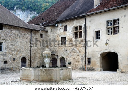 Baume Abbey, in its village of Baume-les-Messieurs, Jura, France, was founded in the early tenth century, as a Benedictine abbey. - stock photo