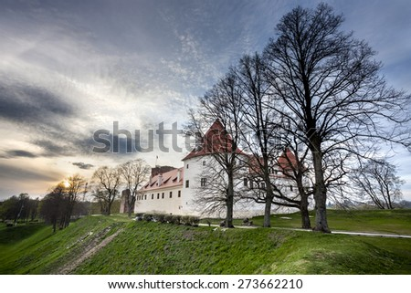 Bauska castle restored part during sunset time. HDR image - stock photo